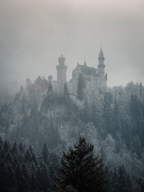 White and Gray Castle on Top of Mountain