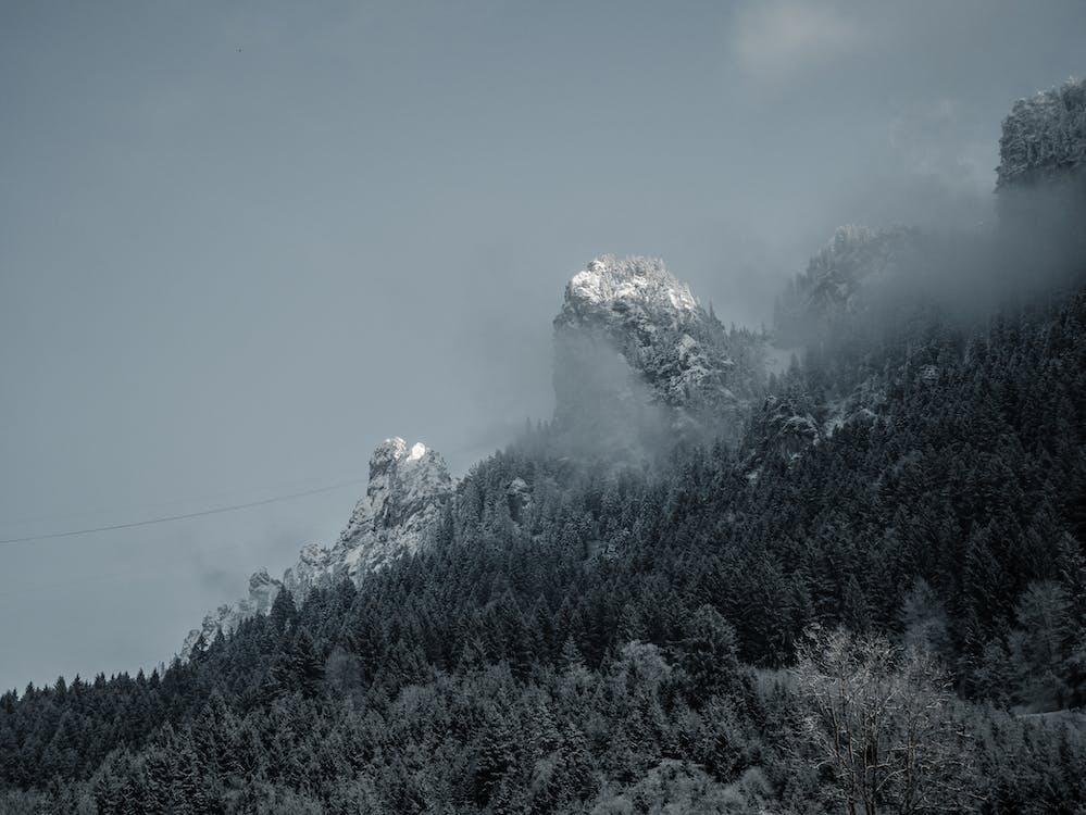 Snow Covered Mountain Under Foggy Sky