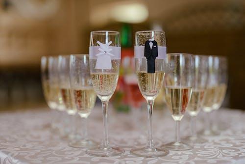 Glasses of sparkling wine arranged on table in restaurant during wedding celebration