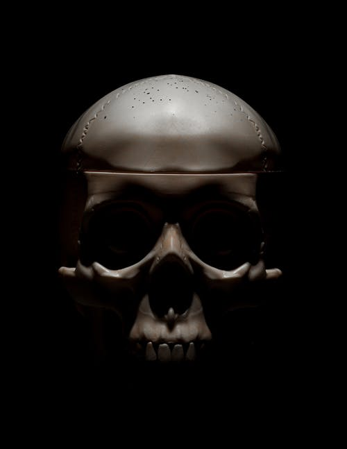 Frightening skull of person in darkness
