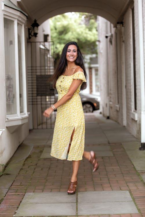 Glad woman walking alone on street