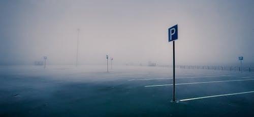 Empty parking lot in foggy weather