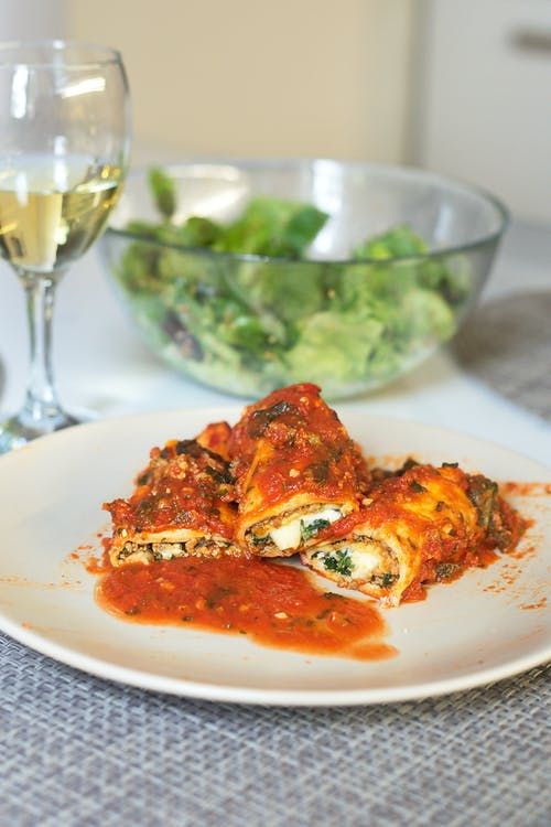 Delicious tomato roll and wineglass