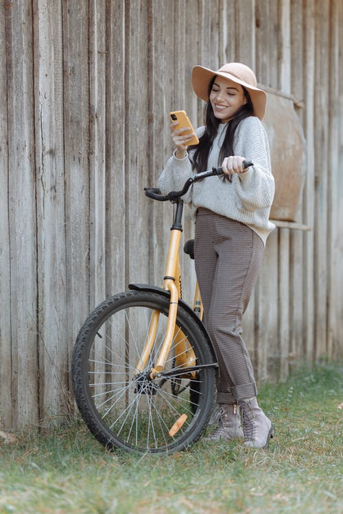 Girl in White Sweater Riding Bicycle