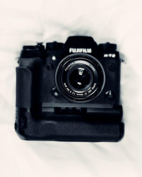 Foto d'estoc gratuïta de afició, artefacte, blanc i negre, botó