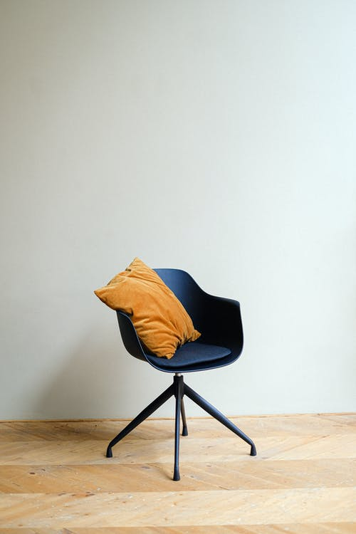 Blue and Black Chair With Blue Pillow