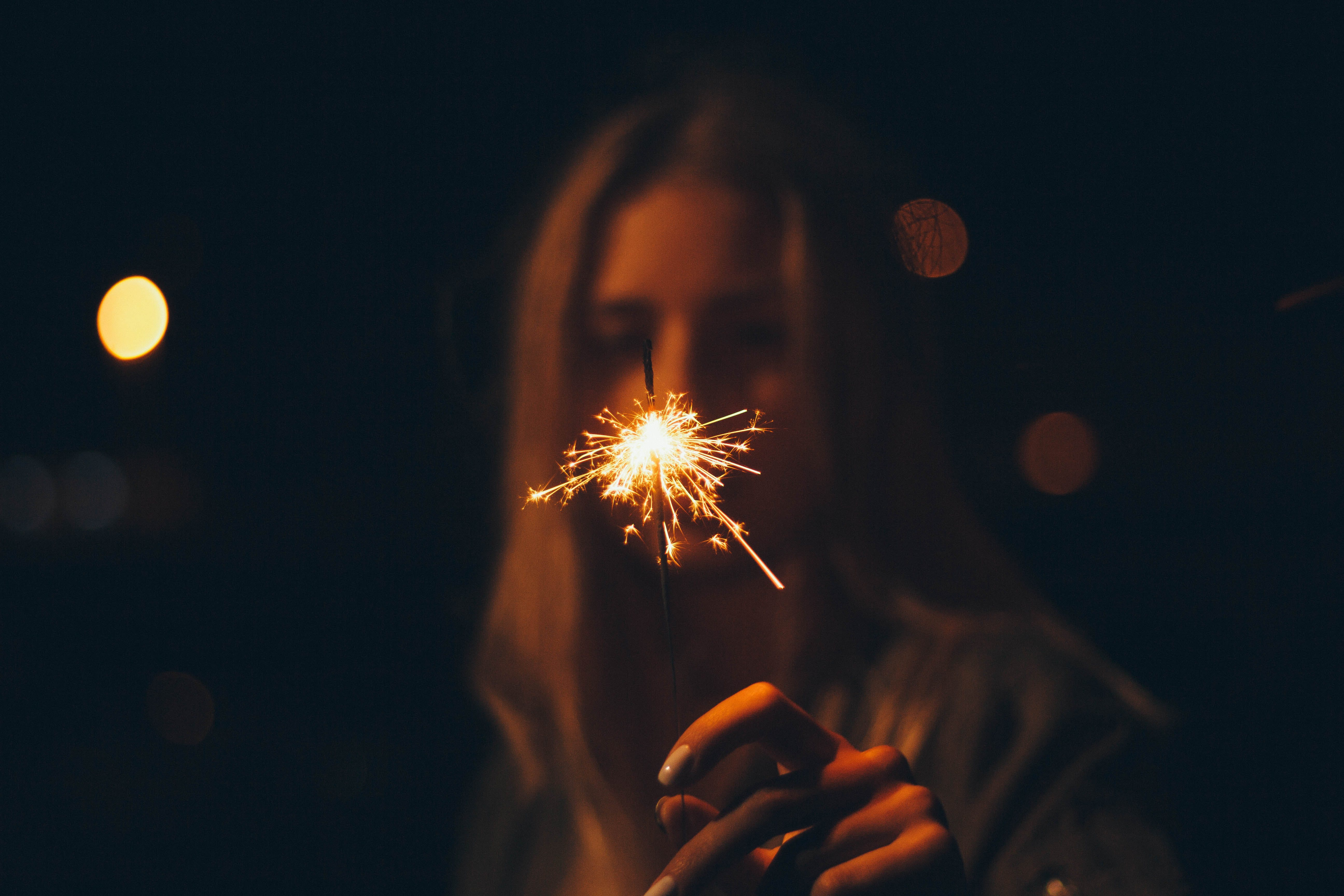 Woman Holding Firecracker