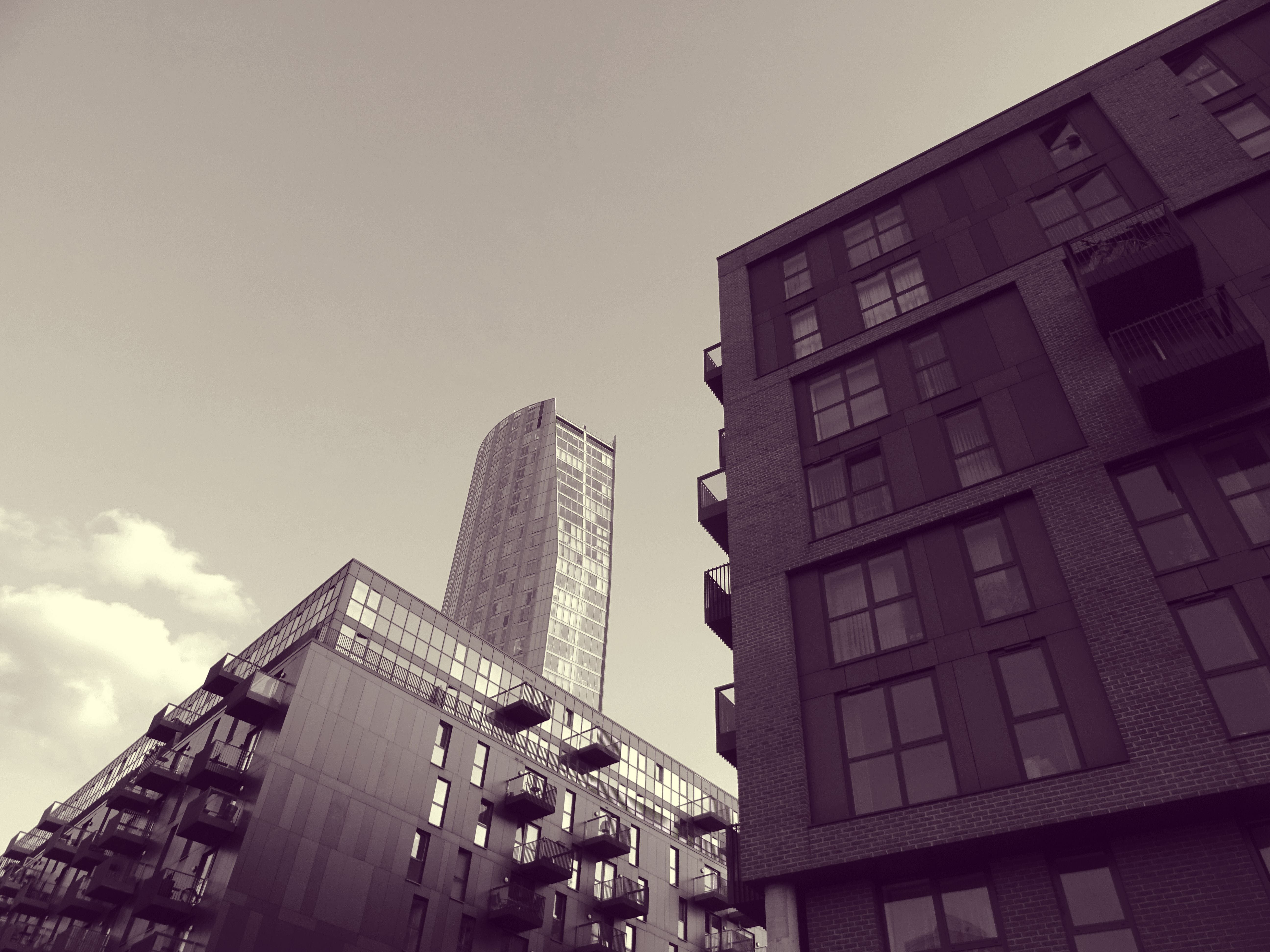 Grayscale and Low Angle Photography of High-rise Building Structures