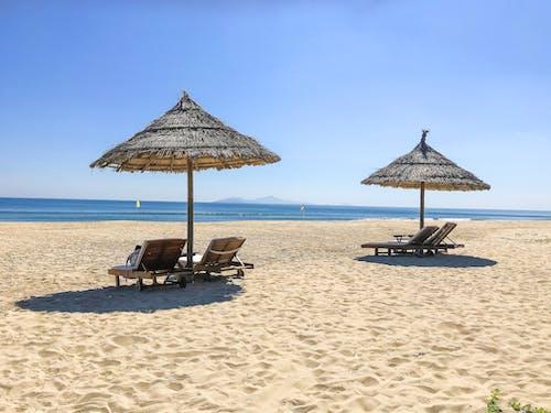 Brown Wooden Beach Lounge Chairs on Beach