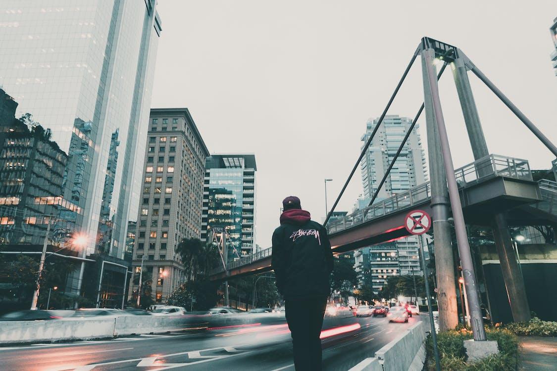 Man in Black Hoodie Looking at the Highway