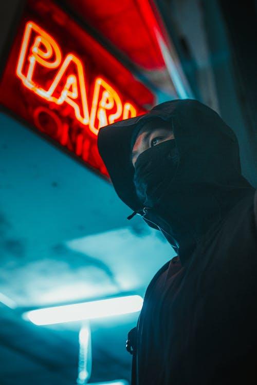 Man in Black Hoodie Wearing Black Mask