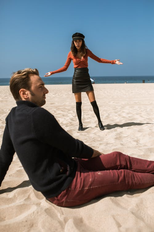 Woman Feeling Upset With Man While Talking On The Beach