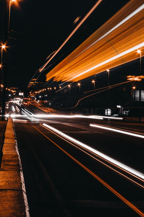 Time Lapse Photography of Road at Night