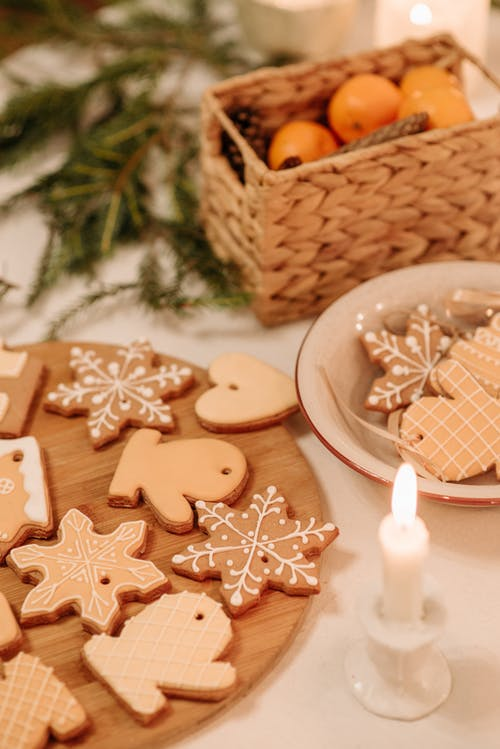 Christmas Cookies On A Wooden Board And Ceramic Bowl