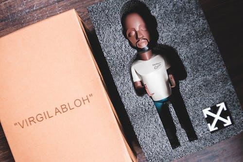 Plastic miniature in packing near carton box