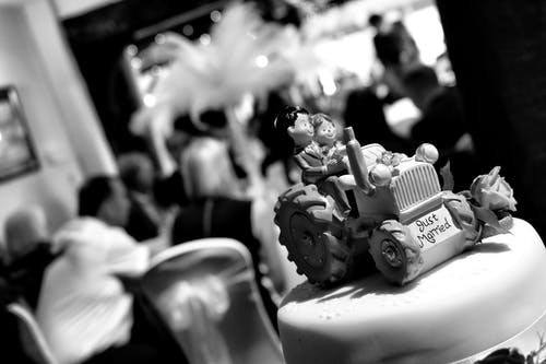 Grayscale of Fondant Cake With Just Married Icing