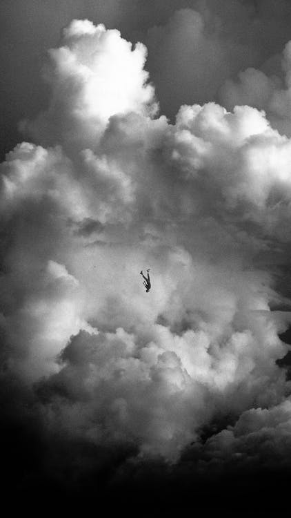 Grayscale Photo of Airplane in Mid Air