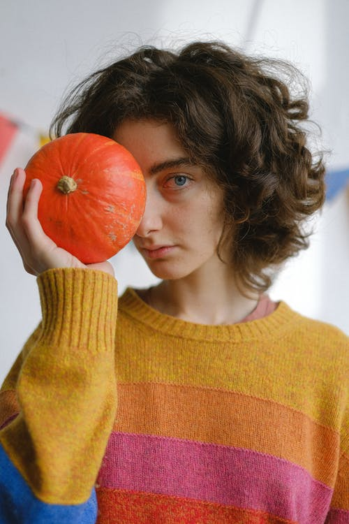 Girl in Yellow Knit Sweater Holding Orange Fruit