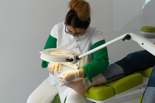 Professional master in beauty salon doing foot procedure