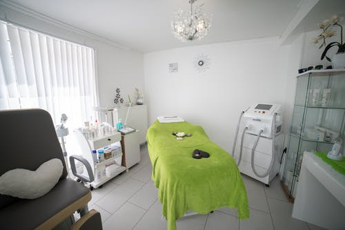 Tools in modern doctor office with couch for massage