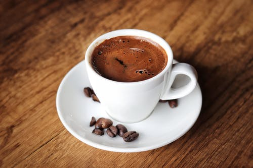 Delicious Cup Of Coffee On White Saucer