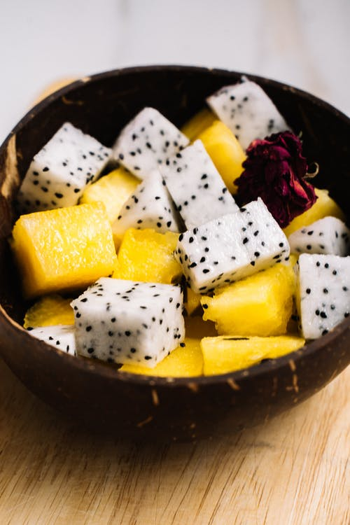 Fresh Fruit Slices on Wooden Bowl