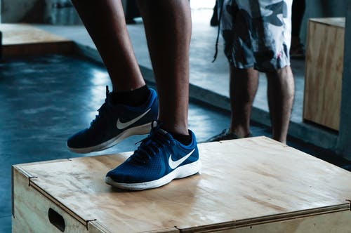 Person in Black and White Nike Athletic Shoes