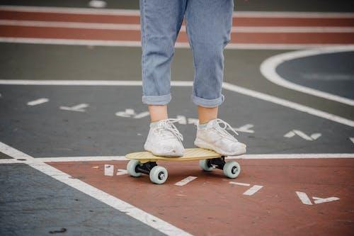 Crop little skater on penny board