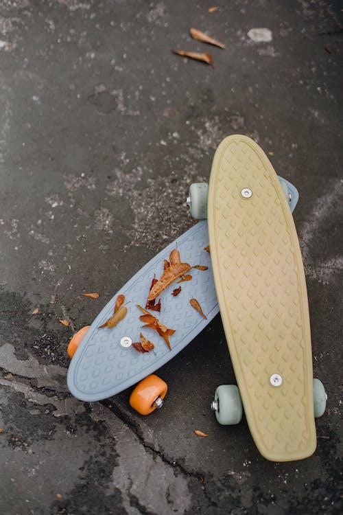 Various skateboards on asphalt street in city