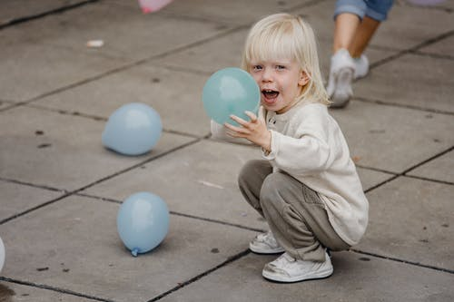 Excited girl with colorful balloons