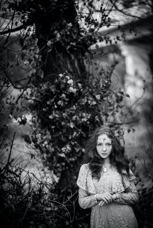 Grayscale Photo of Woman in Floral Dress
