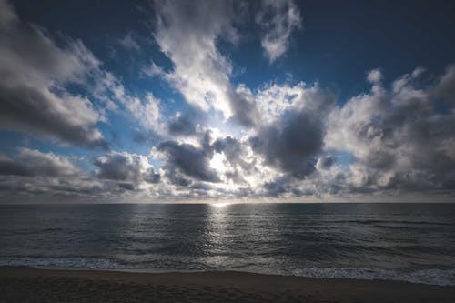 Rippling sea against cloudy sky