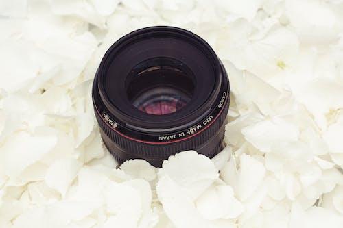 Black Camera Lens on White Textile