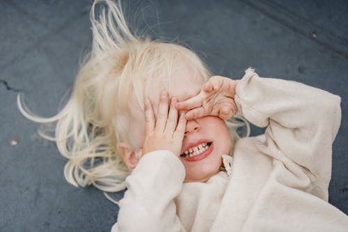 Playful Little Girl Covering Her Eyes