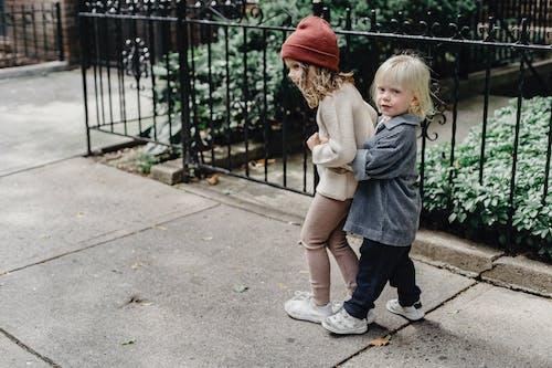 Adorable children cuddling on pathway
