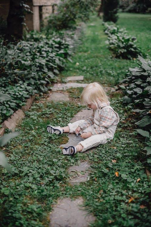 Little boy playing in backyard