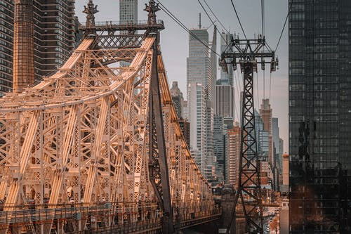 Fragment of famous Brooklyn Bridge with view of Manhattan located in New York in daytime