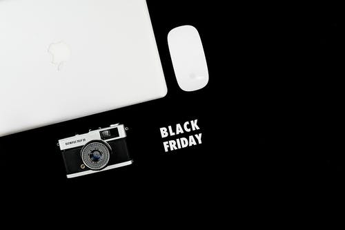 Macbook And Camera On Black Background