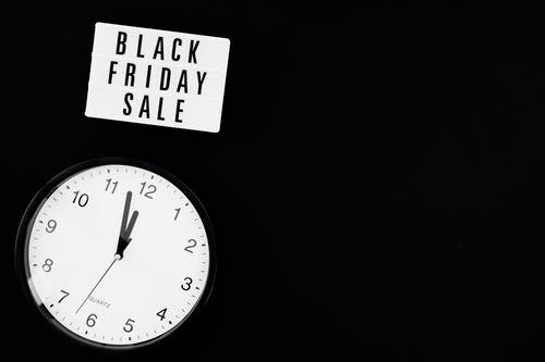 Black and White Analog Wall Clock Showing Time Of Black Friday Sale