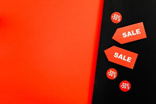 A Red Sale Tags on Red and Black Background