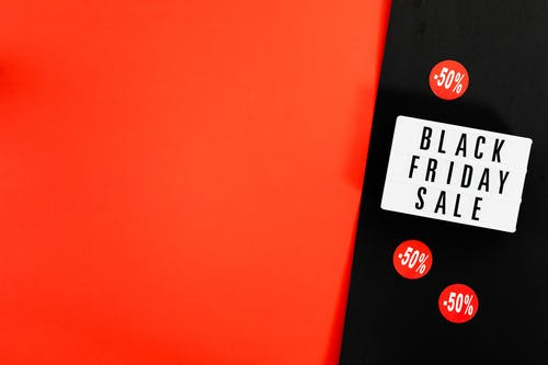 Black Friday Sale Sign And 50% Discount Rate On Black And Red Background