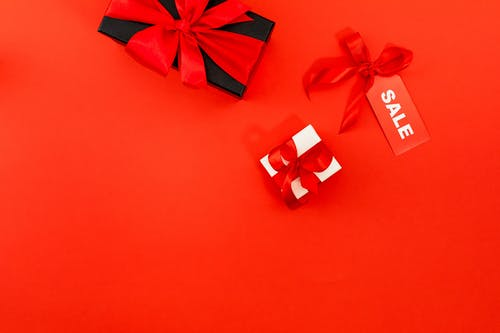 Black And White Gift Boxes On Red Surface