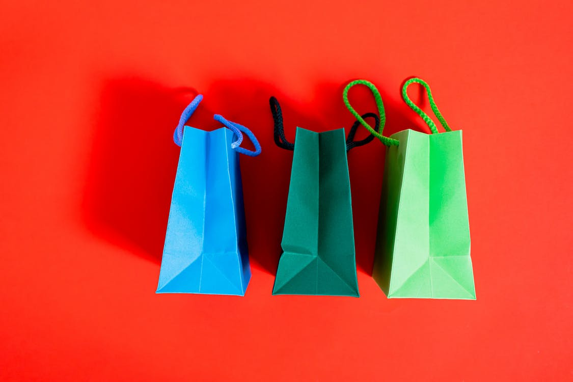Shopping Bags On A Red Surface