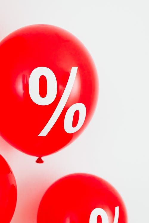 Close-Up View of a Red Balloon With Percentage Symbol