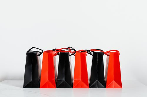 Black and Red Paper Bags on White Background