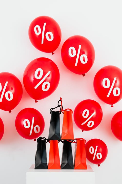 Paper Bags And Balloons With Percent Sign