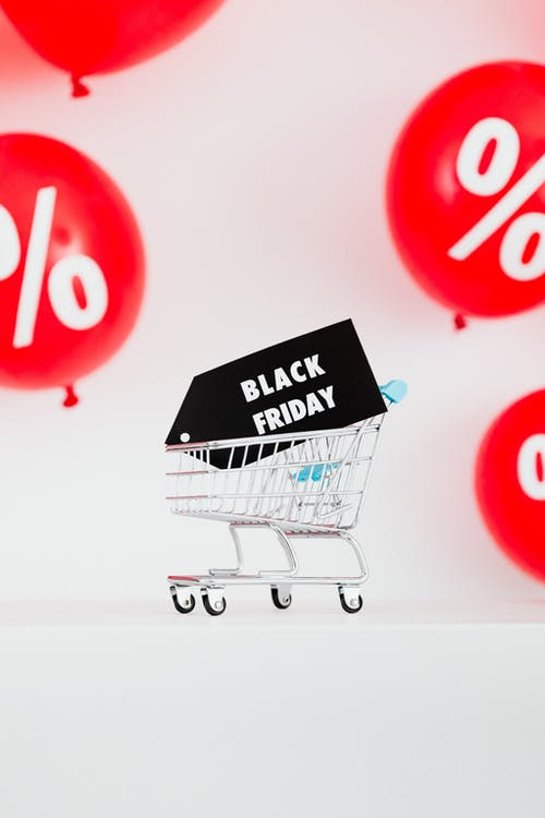 A Black Friday Sale Signage in a Miniature Shopping Cart