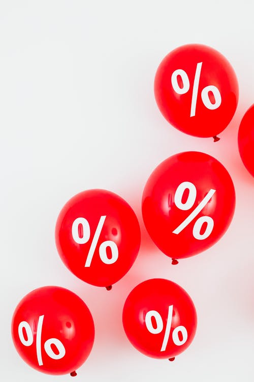 Red Balloons With Percentage Symbols on White Background