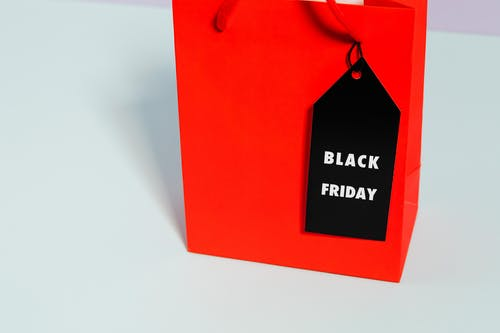 Red Paper Bag With Black Friday Tag