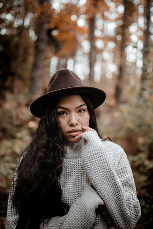 Woman in Black Hat and White Sweater